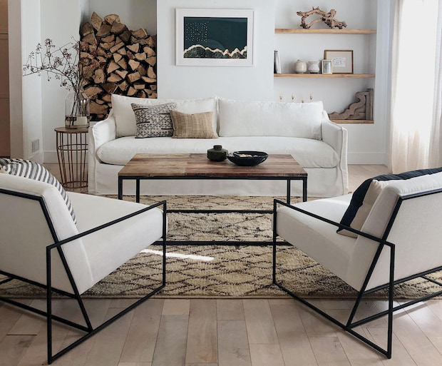 white comfy sofa with two white chairs