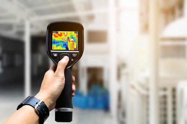 technician use thermal imaging camera to check temperature in fa