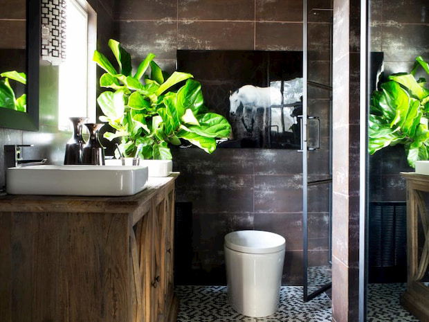 bathroom with green plants in it