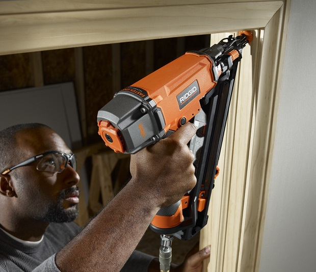 Close-up of working with nail gun