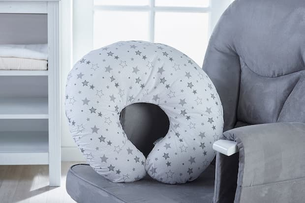 nursing pillow with grey stars on a nursing chair