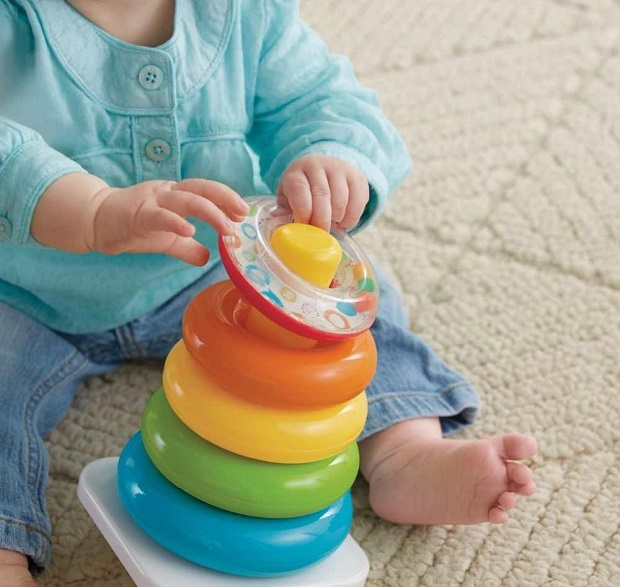Baby playing with ring stack