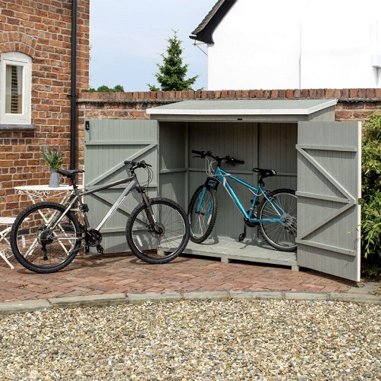 grey wooden bike shed