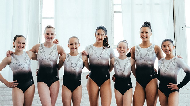 Girls in different sizes of gymnastic leotards