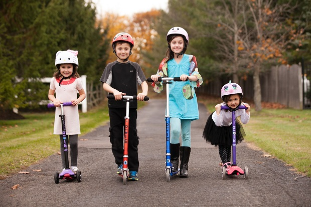 four kids on scooters