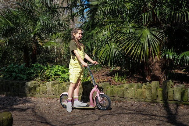 teen girl on scooter