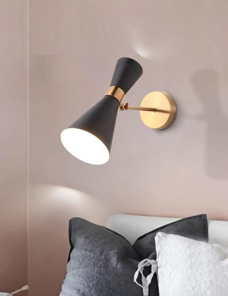 adjustable wall light over the bed